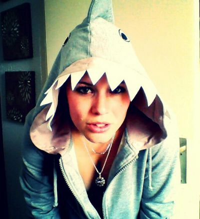 Opposite to what I mean.. this is a person in shark clothing.. these guys are sharks in people clothing.